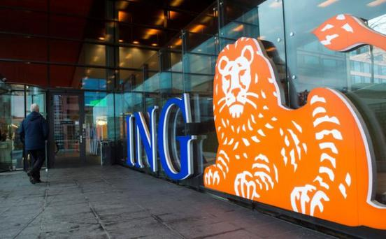 A man walks past the logo of ING Group NV at a branch office in Amsterdam, Netherlands January 9, 2014. REUTERS/Toussaint Kluiters/File photo