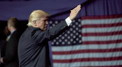 Republican Presidential candidate Donald Trump greets supporters during a campaign rally