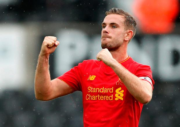 Liverpool's Jordan Henderson celebrates after the game