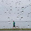Met Éireann has issued alerts over heavy rain