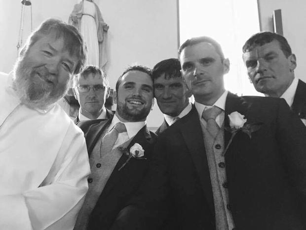 Fr. Pat poses with the groom and groomsmen after marrying Sinead and Chris O'Donnell
