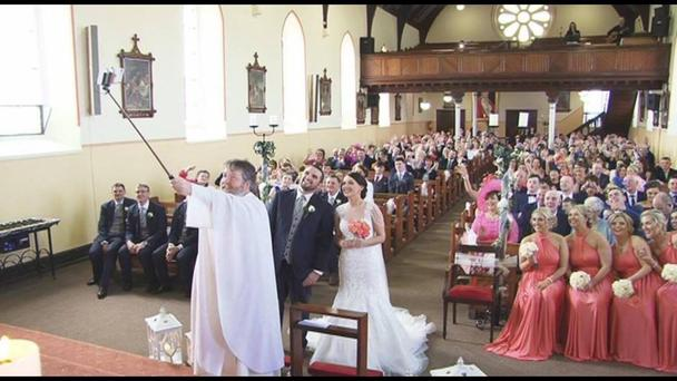 An image of Fr. Pat Ward taking a selfie at the wedding of Sinead and Christopher O'Donnell. Image Credit: I Do Wedding DVDs