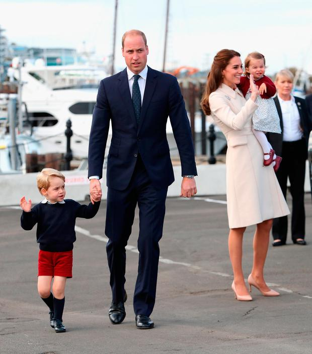 Prince William, Duke of Cambridge, Prince George of Cambridge, Catherine, Duchess of Cambridge and Princess Charlotte wave as they leave from Victoria Harbour to board a sea-plane on the final day of their Royal Tour of Canada