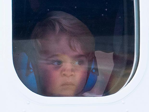 Prince George of Cambridge presses his face against the window as he leaves from Victoria Harbour aboard a sea-plane on the final day of their Royal Tour of Canada on October 1, 2016 in Victoria, Canada.