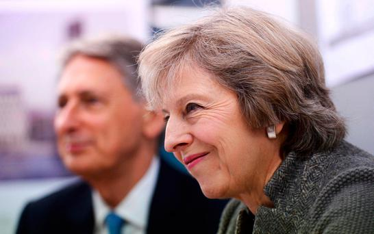 British Prime Minister Theresa May and Chancellor of the Exchequer Philip Hammond during a visit to a construction site in Birmingham yesterday, where new HSBC offices are being built. REUTERS/Stefan Rousseau/Pool