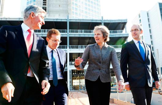 Prime Minister Theresa May (2nd R) during a visit to a construction site in Birmingham, where new HSBC offices are being built. REUTERS/Stefan Rousseau/Pool