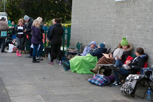 Parents queue outside Clonturk College to enrol for the 2017/2018 school year. Photo: Kyran O'Brien