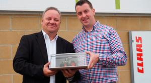 Seamus Quigley (right) receives the Claas Tractor Sales Performance Award from Thierry Panadero