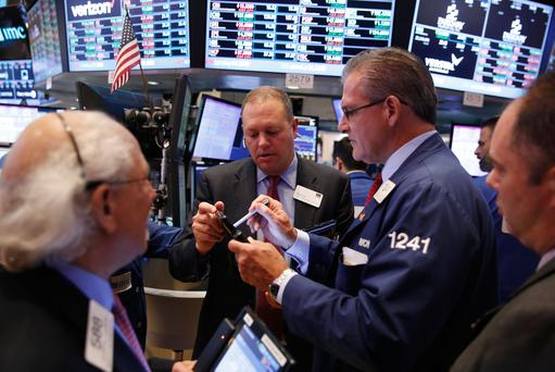 Traders work on the floor of the New York Stock Exchange (NYSE) as the market closes in New York