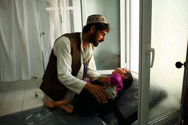 Qudus brought his four year old dauger khal Bibi in after she fell through the roof of their home and injured her leg