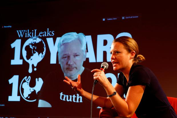Julian Assange, Founder and Editor-in-Chief of WikiLeaks via video link and Sarah Harrison, a WikiLeaks journalist attend a press conference on the occasion of the 10 year anniversary celebration of WikiLeaks in Berlin, Germany, October 4, 2016