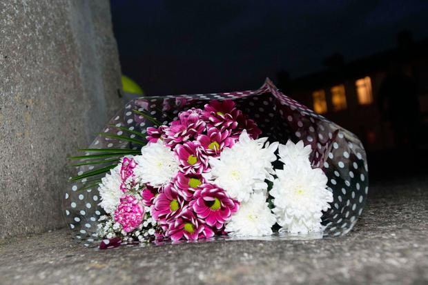 Flowers at the scene where 2 bodies where found in a house Milrose estate Bluebell Dublin. Photo: Gareth Chaney Collins