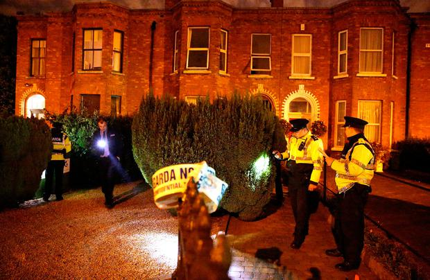 Gardai search for evidence at a house on Dublins South Circular Road following a fatal incident. Picture; Gerry Mooney