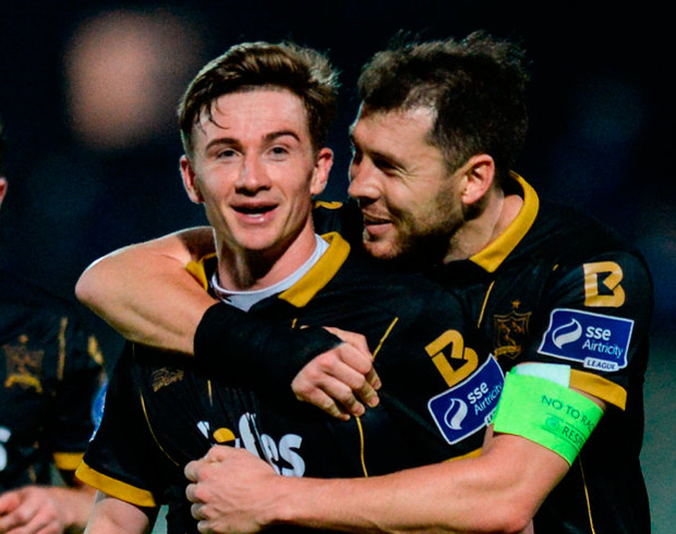 Dundalk's Ronan Finn, left, and Brian Gartland celebrate after the match. Photo: Oliver McVeigh/Sportsfile