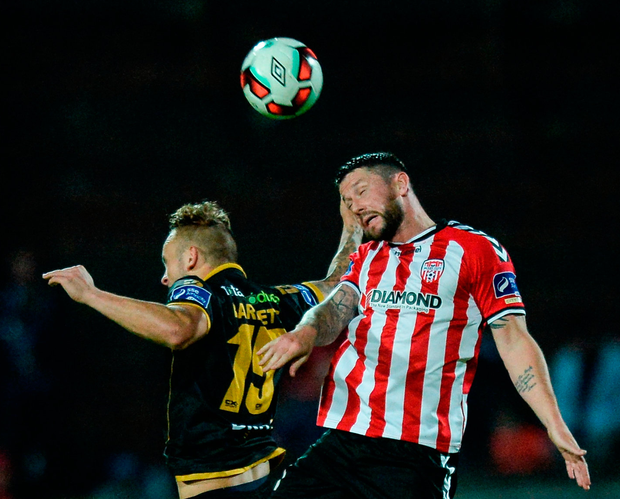 Derry City's Rory Patterson in action against Dundalk's Patrick Barret. Photo: Oliver McVeigh/Sportsfile