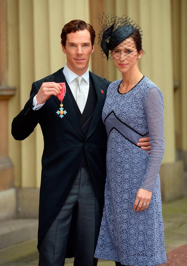 Actor Benedict Cumberbatch with his wife Sophie Hunter after receiving the CBE (Commander of the Order of the British Empire) from Queen Elizabeth II for services to the performing arts and to charity during an Investiture Ceremony at Buckingham Palace on November 10, 2015 in London, England. (Photo by Anthony Devlin - WPA Pool / Getty Images)