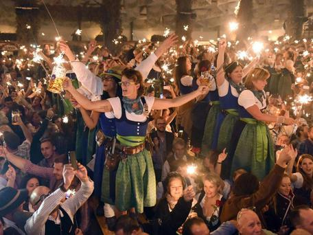 Festival staff in the Hofbraeu tent on the last day of the Oktoberfest beer festival in Munich, Germany