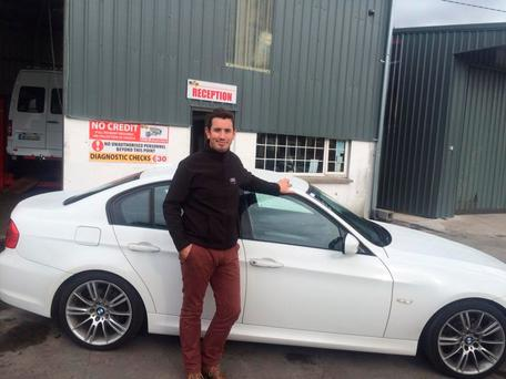John Kelly with the recovered BMW