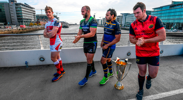 Andrew Trimble, John Muldoon, Isa Nacewa and Peter O'Mahony feel the breeze coming up the River Liffey as they prepare for the photographs at yesterday's launch of the Champions Cup at Spencer Dock in Dublin. Photo by Stephen McCarthy/Sportsfile