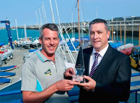 David Mulqueen (right) of Philips Ireland presents the Philips manager of the month for August to Ireland's Olympic sailing coach Rory Fitzpatrick, who was joint winner along with Ireland's Olympic rowing manager Morten Espersen.