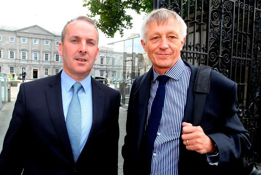 Chief executive of Dublin Bus Ray Coyne (left) and chief executive of Irish Rail David Franks after meeting with the Oireachtas Transport,Tourism and Sports Committee at Leinster House yesterday. Photo: Tom Burke