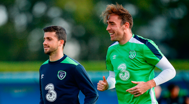 Shane Long – alongside team-mate Richard Keogh in training yesterday – is 17 games without a goal for club and country but Ireland must play to his strengths tonight Photo by Seb Daly/Sportsfile