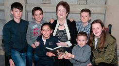 Mary O'Rourke with her grandchildren at the launch of her new book, 'Letters of My Life'. Photo: Brian McEvoy
