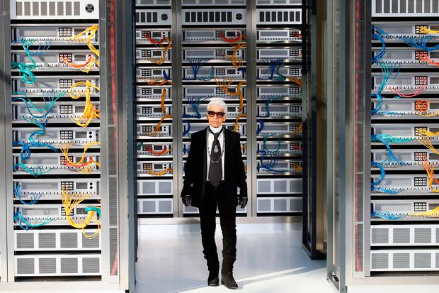 Fashion designer Karl Lagerfeld appears at the end of the presentation of Chanel's Spring-Summer 2017 ready-to-wear fashion collection presented Tuesday, Oct.4, 2016 in Paris. (AP Photo/Francois Mori)