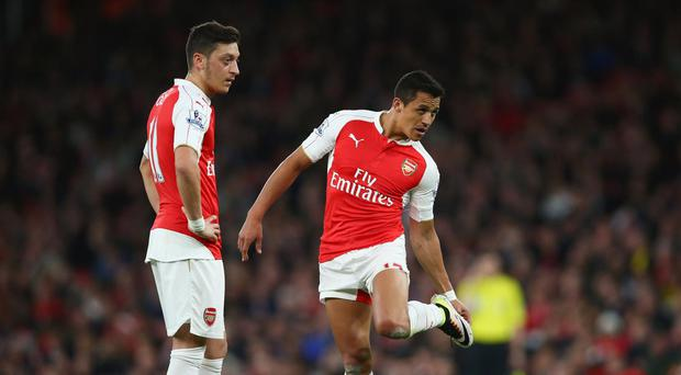 Mesut Özil and Alexis Sanchez are demanding £250,000-a-week to sign new contracts with Arsenal. Getty