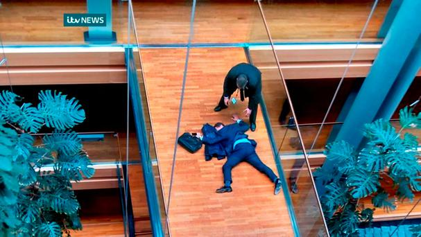 UK Independence Party MEP, Steven Woolfe, lying face-down on a walk-way inside the European Parliament building in Strasbourg in eastern France. Picture: AFP PHOTO / ITV NEWS