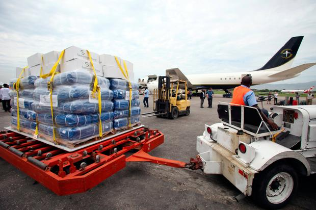 Relief aid donated by Samaritan's Purse International Relief is being transportet on a tarmac trolley at the airport in Port-au-Prince, Haiti. Photo: Reuters