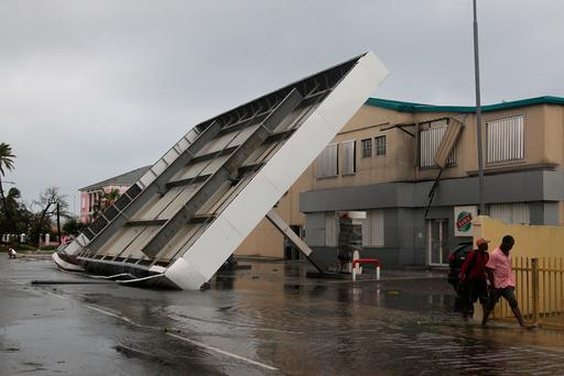The roof of a gas lays collapsed in the aftermath of Hurricane Matthew in Nassau, Bahamas, Thursday, Oct. 6, 2016. The head of the Bahamas National Emergency Management Authority, Capt. Stephen Russell, said there were many downed trees and power lines, but no reports of casualties. (AP Photo/Tim Aylen)