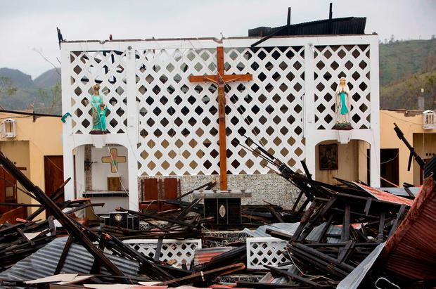 Saint Anne church lays totally destroyed by Hurricane Matthew in Camp Perrin, a district of Les Cayes, Haiti, Thursday, Oct. 6, 2016. Two days after the storm rampaged across the country's remote southwestern peninsula, authorities and aid workers still lack a clear picture of what they fear is the country's biggest disaster in years. (AP Photo/Dieu Nalio Chery)