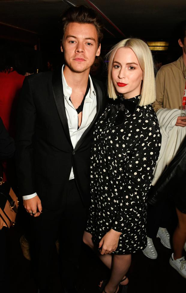 Harry Styles (L) and sister Gemma Styles attend the Another Man A/W launch event hosted by Harry Styles, Alister Mackie and Kris Van Assche at Albert's Club on October 6, 2016 in London, England. (Photo by David M. Benett/Dave Benett/Getty Images for Dazed)