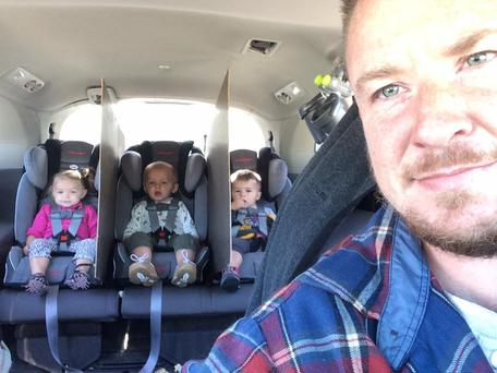 Dad-of-three Jake White from Ohio shared an image of the clever car trick that has helped him achieve some zen while ferrying his triplets around.