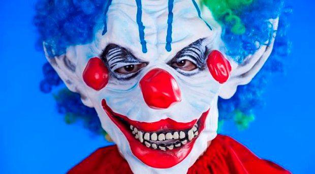 The clown was wearing grey tracksuit bottoms, red shoes, a multi-coloured top, a mask and had his face painted.