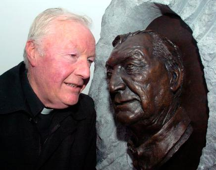 Charlie Haughey' s brother Fr Eoghan Haughey admiring bronze bust of former Taoiseach