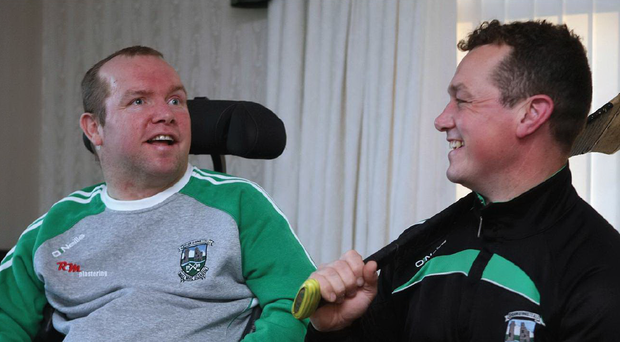 Veteran Ballygalget goalkeeper Graham Clarke (right) and his brother Declan who suffers with multiple sclerosis