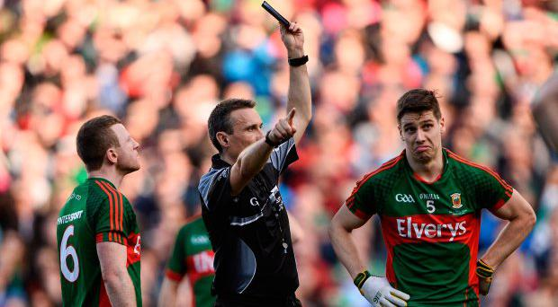 Ref Maurice Deegan shows Lee Keegan a controversial black card last Saturday with Mayo team-mate Colm Boyle (L) looking on. Picture: Sportsfile