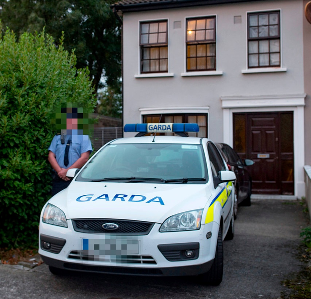 Gardai at the brothers' home in Bluebell, Dublin Photo: Arthur Carron