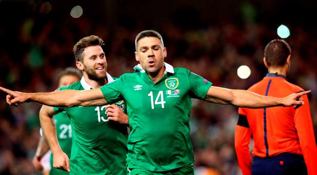 Jonathan Walters (C) celebrates after scoring his team's first goal from a penalty during a UEFA Euro 2016 Group D qualifying second leg play-off football match between Ireland and Bosnia Herzegovina at the Aviva stadium in Dublin on November 16, 2015. AFP PHOTO / PAUL FAITHPAUL FAITH/AFP/Getty Images