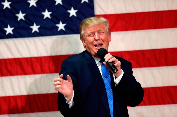 Republican presidential candidate Donald Trump speaks at a town hall-style forum in Sandown Photo: AP