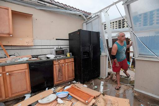 Homeowner Joe Lovece surveys the damage to the kitchen at the back of his oceanfront home after the eye of Hurricane Matthew passed Ormond Beach, Florida. Photo: Reuters