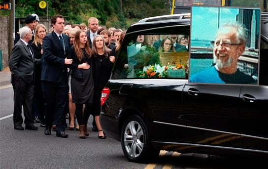 Caitroina McCoy, centre, follows the coffin of her husband Michael McCoy (inset) into St. Maelruain's Church of Ireland in Tallaght.