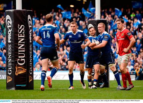 Jamison Gibson-Park of Leinster, third right, is congratulated by teammates, from left, Rory O'Loughlin, Garry Ringrose and Dan Leavy after coring his side's third try during the Guinness PRO12 Round 6 match between Leinster and Munster at the Aviva Stadium in Lansdowne Road, Dublin. Photo by Seb Daly/Sportsfile