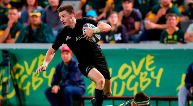 South Africa's Jaco Kriel lies on the pitch next to New Zealand's Beauden Barrett during the Rugby Championship match between South Africa and New Zealand at Kingspark Rugby stadium in Durban on October 8, 2016. / AFP PHOTO / ANESH DEBIKYANESH DEBIKY/AFP/Getty Images