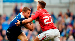 Garry Ringrose of Leinster is tackled by Ian Keatley of Munster at the Aviva Stadium yesterday.. Photo: Stephen McCarthy/Sportsfile