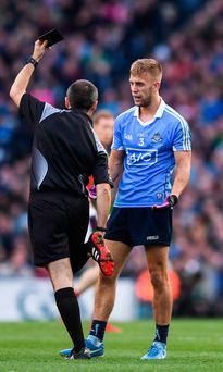 Dublin's Jonny Cooper receives a black card from referee Maurice Deegan during the GAA Football All-Ireland Senior Championship Final Replay. Photo: Stephen McCarthy/Sportsfile
