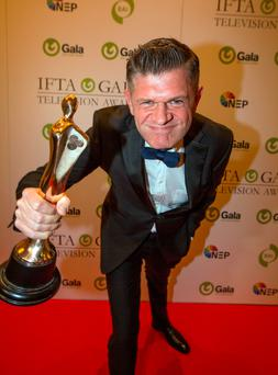 Cutting a dash: Brendan O'Connor received the award for Best Entertainment Show for for Cutting Edge, at the IFTA gala television awards ceremony held at the DoubleTree Hilton, Dublin. Photo: Mark Condren