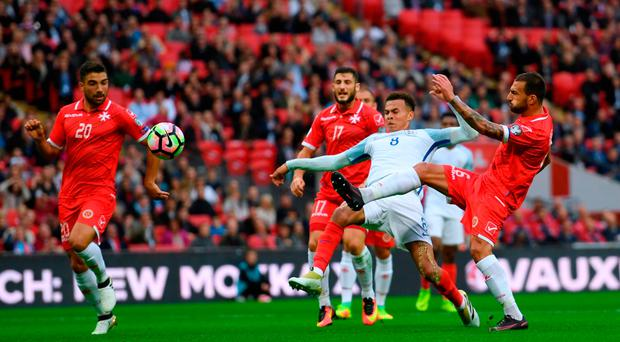 Dele Alli of England scores his teams second goal. Photo by Shaun Botterill/Getty Images